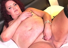 Redheaded curvaceous lady-boy wanks